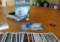 The Resistance: a game of secret identities, deduction, and deception. (Provided)