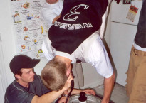 Student athlete performs a Keg-Stand.