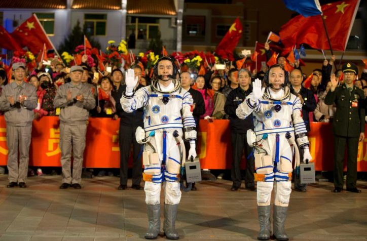 Taikonauts Jing Haipeng and Chen Dong wave before the launch. (Image provided)
